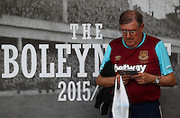 A West Ham United fan reads the match day program   during the Barclays Premier League match between West Ham United and Swansea City  played at Boleyn Ground , London on 7th May 2016