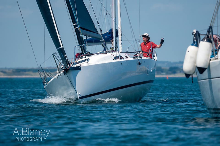 Captain cool. Mike Evans brings Snapshot cleanly through the boats summer-anchored in Howth Sound at Ireland's Eye, on his way to line honours and the IRC win. Photo: Annraoi Blaney