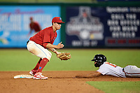 Clearwater Threshers second baseman Jose Gomez (3) waits for a throw as Ray-Patrick Didder (13) slides in safely on a stolen base during a game against the Florida Fire Frogs on June 1, 2018 at Spectrum Field in Clearwater, Florida.  Florida defeated Clearwater 12-10.  (Mike Janes/Four Seam Images)
