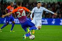 Gylfi Sigurdsson of Swansea City  challenges John Stones of Manchester City during the EFL Cup Third Round Premier match between Swansea City and Manchester City at The Liberty Stadium. Wednesday 21 September 2016