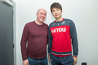 FAO THE SUN SPORTS PICTURE DESK<br /> Th Sun sports reporter Justin Allen and Swansea City FC footballer Ki Sung Yueng at the Fairwood Training Ground in Swansea, Wales, UK. Thursday 15 March 2018