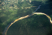 Araguaia River, Amazon, Brazil. Aerial view; river, tributary and sediment deposition.