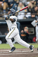 Michigan Wolverines second baseman Ako Thomas (4) follows through on his swing against the Maryland Terrapins on April 13, 2018 in a Big Ten NCAA baseball game at Ray Fisher Stadium in Ann Arbor, Michigan. Michigan defeated Maryland 10-4. (Andrew Woolley/Four Seam Images)