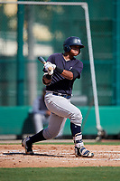 GCL Yankees West first baseman Nelson Alvarez (36) follows through on a swing during the first game of a doubleheader against the GCL Braves on July 30, 2018 at Champion Stadium in Kissimmee, Florida.  GCL Yankees West defeated GCL Braves 7-5.  (Mike Janes/Four Seam Images)