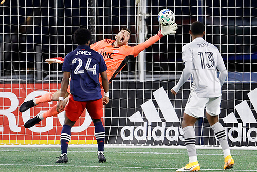 20th November 2020; Foxborough, MA, USA;  New England Revolution goalkeeper Matt Turner tries to stop the shot from Montreal Impact forward Romell Quioto during the MLS Cup Play-In game between the New England Revolution and the Montreal Impact