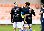 Dundee United v St Johnstone…..01.08.20   Tannadice  SPFL<br />Michael O'Halloran and  Danny McNamara wearing Show Racism The Red Card T-shirts during the warm-up<br />Picture by Graeme Hart.<br />Copyright Perthshire Picture Agency<br />Tel: 01738 623350  Mobile: 07990 594431
