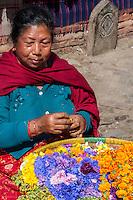 Nepal, Kathmandu.  Street Vendor Selling Flowers.