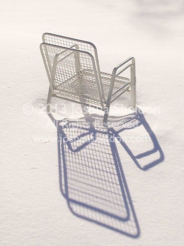 Summer chairs left out in the snow<br />