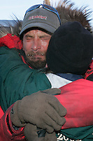 Tuesday March 13, 2007   ----   Lance Mackey, the 2007 Iditarod champion cries with joy as he hugs his mother, Kathy Smith after he arrives in Nome.