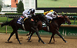 LOUISVILLE, KY -JUNE 04: Alsvid (#5, green saddle cloth) ridden by Chris Landeros, wins the Aristides Stakes over Limousine Liberal (#3, blue saddle cloth, Corey Lanerie) and third place finisher Union Jackson (Ricardo Santana Jr.) Alsvid (Officer x Reagle Mary, by Afternoon Deelites) is owned by Black Hawk Stable (James Rogers) and trained by Chris A. Hartman. (Photo by Mary M. Meek/Eclipse Sportswire/Getty Images)