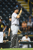 Jupiter Hammerheads catcher Josh Adams (10) warms up the pitcher in between innings during a game against the Bradenton Marauders on April 17, 2014 at McKechnie Field in Bradenton, Florida.  Bradenton defeated Jupiter 2-1.  (Mike Janes/Four Seam Images)