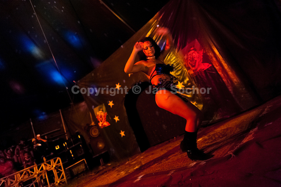 Bianca Rocio, a Salvadorean dancer, performs a dancing act at the Circo Brasilia, a family run circus travelling in Central America, 10 May 2011. The Circo Brasilia circus belongs to the old-fashioned traveling circuses with a usual mixture of acrobat, clown and comic acts. Due to the general loss of popularity caused by modern forms of entertainment such as movies, TV shows or internet, these small family enterprises balance on the edge of survival. Circuses were pushed away and now they have to set up their shows in more remote villages. The circus art and culture is slowly dying in Latin America.