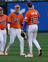 Right fielder Steven Duggar (9) of the Clemson Tigers, left, celebrates with Steve Wilkerson (17) after a game against the South Carolina Gamecocks on Saturday, March 2, 2013, at Fluor Field at the West End in Greenville, South Carolina. Clemson won the Reedy River Rivalry game 6-3. (Tom Priddy/Four Seam Images)