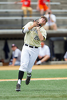 Wake Forest Demon Deacons third baseman Will Craig (22) fields an infield pop fly during the game against the Virginia Cavaliers at Wake Forest Baseball Park on May 17, 2014 in Winston-Salem, North Carolina.  The Demon Deacons defeated the Cavaliers 4-3.  (Brian Westerholt/Four Seam Images)