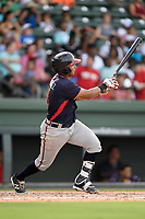 Catcher Carlos Martinez (4) of the Rome Braves bats in a game against the Greenville Drive on Sunday, August 13, 2017, at Fluor Field at the West End in Greenville, South Carolina. Greenville won, 2-1. (Tom Priddy/Four Seam Images)