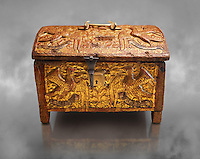 Gothic box made from poplar wood with stucco reliefs, gold leaf gold decorations and traces of polychrome iron and brass 2nd quarter 15th century, possibly from Barcelona, Catalunya, Spain. National Museum of Catalan Art, Barcelona, Spain, inv no: MNAC 12120. Against a grey textured background.