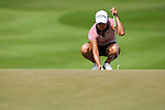 CHON BURI, THAILAND - FEBRUARY 20:  Yani Tseng of Taiwan lines up a putt on the 1st green during day four of the LPGA Thailand at Siam Country Club on February 20, 2011 in Chon Buri, Thailand. Photo by Victor Fraile / The Power of Sport Images
