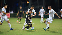 LAKE BUENA VISTA, FL - JULY 18: Brian Rodríguez #17 of LAFC is surrounded by Emil Cuello #27, Joe Corona #15 and Perry Kitchen #2 of LA Galaxy during a game between Los Angeles Galaxy and Los Angeles FC at ESPN Wide World of Sports on July 18, 2020 in Lake Buena Vista, Florida.