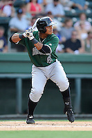 Catcher Gabriel Cornier (47) of the Augusta GreenJackets bats in a game against the Greenville Drive on Sunday, July 13, 2014, at Fluor Field at the West End in Greenville, South Carolina. Greenville won, 8-5. (Tom Priddy/Four Seam Images)
