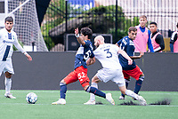 FOXBOROUGH, MA - JULY 4: Michael Tsicoulias #52 of the New England Revolution II and Tyler Polak #3 of Greenville Triumph SC battle for the ball near the Greenville Triumph SC goal during a game between Greenville Triumph SC and New England Revolution II at Gillette Stadium on July 4, 2021 in Foxborough, Massachusetts.