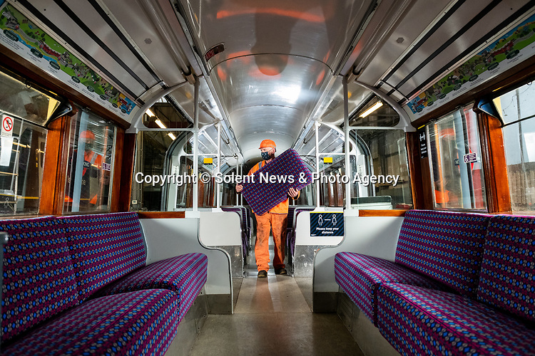 Pictured: Tony Long, a maintenance fitter for South West Trains stands inside the carriage of the British Rail Class 483 Island Line train carrying removed seating at the workshop at Ryde St Johns Road train station, Isle of Wight after its last passenger service on Sunday 3rd January 2021, ahead of being delivered to the Isle of Wight Steam Railway as the line prepares to unveil a new fleet of London Underground trains in the spring. <br /> <br /> The trains, which previously served the London Underground's Northern Line are estimated to have travelled over 3 million miles in their 82 years of service. The Island Line is currently undergoing 3 months of refurbishment ahead of unveiling a new fleet of trains, five British Rail Class 484, extensively refurbished by Vivarail.<br /> <br /> The previous two fleet service will see the train (pictured) being delivered to the Isle of Wight Steam Railway, and the other to the London Traction Transport Group with the intention of running it on the Epping Ongar Railway.<br /> <br /> In keeping with Island Line's traditions, the Class 484 trains are former London Underground trains which served on the District Line and will modernise the service on the island.<br /> <br /> © Jordan Pettitt/Solent News & Photo Agency<br /> UK +44 (0) 2380 458800