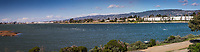 Winds were gusting to 35 mph and hundreds of gulls settled onto the waters of San Leandro Bay at the Martin Luther King Jr. Regional Shoreline in Oakland, California.  A multi-image panoramic.
