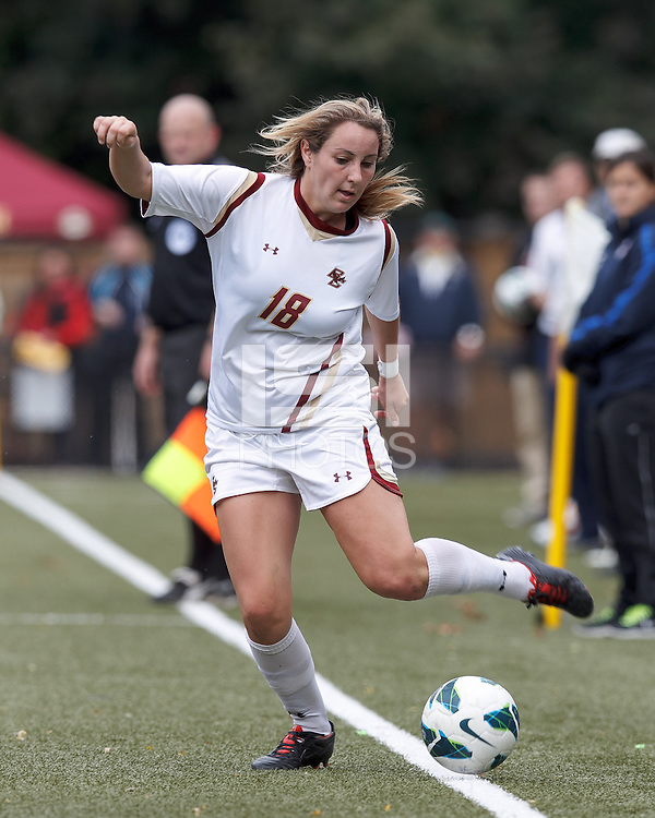 Boston College midfielder Patrice Vettori (18) keeps the ball in play.  University of North Carolina (blue) defeated Boston College (white), 1-0, at Newton Campus Field, on October 13, 2013.