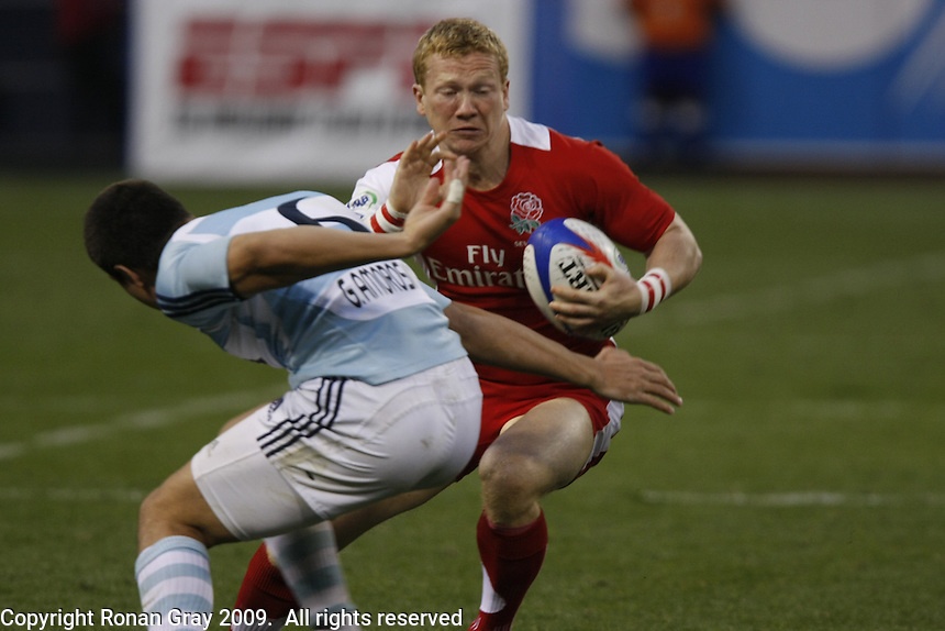 February 15 2009, San Diego, CA, USA:  The IRB USA Sevens Tournament at Petco Park in Downtown San Diego.  England number 11, Tom Biggs gives Argentina number 5, Agustin Figuerola the slip during the final of the USA Sevens.  Argentina emerged as the tournament champions after two days of fast paced action in Downtown San Diego.