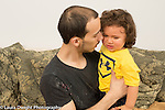 20 month old toddler boy sad crying talked gently to by father
