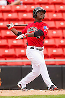 Odubel Herrera #2 of the Hickory Crawdads follows through on his swing against the Greensboro Grasshoppers at L.P. Frans Stadium on May 18, 2011 in Hickory, North Carolina.   Photo by Brian Westerholt / Four Seam Images