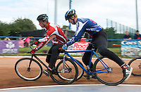 13 SEP 2014 - IPSWICH, GBR - Ollie Riley (right) from Hethersett Hawks gets his wheel trapped under the leg of  Marcus Wadhams from Birmingham Monarchs during a second semi final heat at the 2014 British Open Club Cycle Speedway Championships at Whitton Sports & Community Centre in Ipswich, Great Britain (PHOTO COPYRIGHT © 2014 NIGEL FARROW, ALL RIGHTS RESERVED)