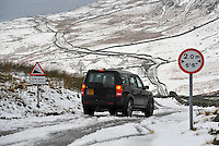 Road signs, Kirkstone Pass, Lake District, Cumbria. 4x4 driving down The Struggle.