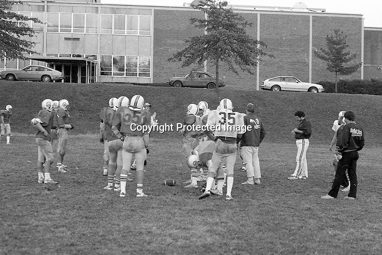 Bethel Park PA:  Bethel Park High School Football Head Coach Bob King clearly explaining what he wants from the scout team during practice.<br /> <br /> Notable players included; future college and NBA star Armen Gilliam (DE), Shawn Morton QB, Steve Berlin (T), Eric Coss (T), Van Richardson (LB), Evan Evanovich (TE).<br /> The team made a great run in the WPIAL AAAA playoffs beating the #2 rated high school football team in the nation, North Hills in 3 overtimes, and then top 5 Gateway the next week.  Came up a little short against Mt Lebanon in the championship game at Pitt Stadium.<br /> Coaches included Head Coach & OC Bob King, Don Porter (DC), Dave George (LB, TE), Leo Henne (DL), Dave Luptak (R, DB), Gerard Runco (R, Secondary), Chuck Boig (QB, DB) and Mike Stewart (RB, DB).