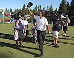 Scott Piercy waves to the crowd after sinking the winning putt on the 18th green at the Reno-Tahoe Open at the Montreux Golf & Country Club in Reno, Nev., on Sunday, Aug. 7, 2011. .Photo by Cathleen Allison
