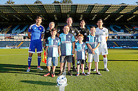 Captains, mascots and match officials ahead of the Friendly match between Wycombe Wanderers and Brentford at Adams Park, High Wycombe, England on 19 July 2016. Photo by David Horn PRiME Media Images.