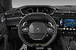Car pictures of steering wheel view of a 2021 Peugeot 508-SW PSE-PHEV 5 Door Wagon Steering Wheel