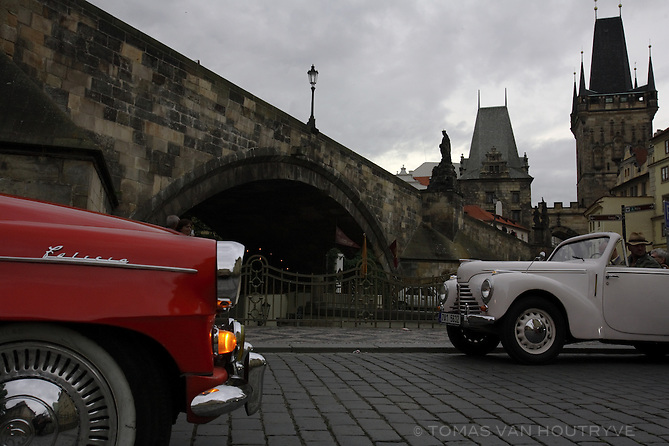 Classic cars pass under the Charles bridge in Prague, Czech Republic on 15 May 2007.