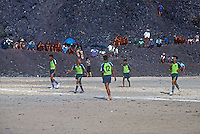 A soccer game in 1996 next to a rubbish dump, Yangon, Myanmar