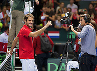 Switserland, Genève, September 20, 2015, Tennis,   Davis Cup, Switserland-Netherlands, Roger Federer waves to the crowd before his interview with Sport 1<br /> Photo: Tennisimages/Henk Koster