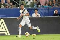 CARSON, CA - SEPTEMBER 21: Julian Araujo #22 of the Los Angeles Galaxy moves with the ball during a game between Montreal Impact and Los Angeles Galaxy at Dignity Health Sports Park on September 21, 2019 in Carson, California.
