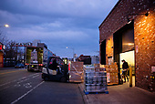 April 21, 2020<br /> Brooklyn, New York<br /> Park Slope<br /> <br /> Trucks bring food deliveries to Whole Foods in Brooklyn at dawn during the height of the coronavirus pandemic.