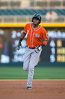 Michael Almanzar (2) of the Norfolk Tides rounds the bases after hitting a home run against the Charlotte Knights at BB&T BallPark on April 20, 2016 in Charlotte, North Carolina.  The Knights defeated the Tides 6-3.  (Brian Westerholt/Four Seam Images)