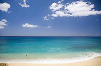 Lone swimmer at Yokohama Beach on the leeward coast of Oahu