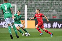 18th May 2020, WESERSTADION, Bremen, Germany; Bundesliga football, Werder Bremen versus Bayer Leverkusen;  Florian Wirtz (Leverkusen) takes on Maximilian Eggestein (Bremen).