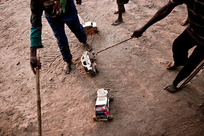 .Youngsters homemade toy cars made from miscellaneous scraps. December 2005 © Stephen Blake Farrington