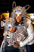 Costumed children watch the festivities of First Night Charlotte 2010. The family-friendly public event (no alcohol allowed) is an annual cultural New Year's Eve celebration held in downtown / uptown / Charlotte center city. Charlotte First Night - An Imagination Celebration brought together artists, musicians, dancers and more from across the country. The New Year's event is organized by Charlotte Center City Partners, which facilitates and promotes the economic and cultural development of this North Carolina urban core.