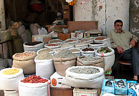 "herbs and spices vendor  look at an empty market after the economic blockade imposed on Palestinians after the victory of Hamas in the legislative elections last year May.20.2007""photo by Fady Adwan"""
