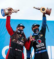 Nov 1, 2020; Las Vegas, Nevada, USA; NHRA pro stock driver Erica Enders (left) celebrates alongside top fuel driver Antron Brown after winning the NHRA Finals at The Strip at Las Vegas Motor Speedway. Mandatory Credit: Mark J. Rebilas-USA TODAY Sports