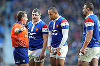 Referee Nigel Owens of Wales gives a yellow card to Gaël Fickou of France (centre) after he tackled Chris Ashton of England without the ball during the Guinness Six Nations match between England and France at Twickenham Stadium on Sunday 10th February 2019 (Photo by Rob Munro/Stewart Communications)