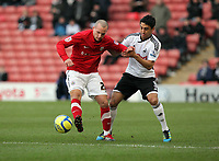 Pictured L-R: Danny Drinkwater challenged by Neil Taylor of Swansea. Saturday 07 January 2012<br /> Re: FA Cup football Barnsley FC v Swansea City FC at the Oakwell Stadium, south Yorkshire.